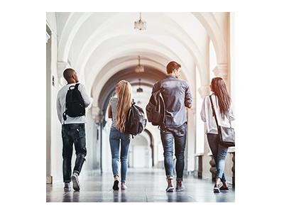 Group of teens walking down hallway